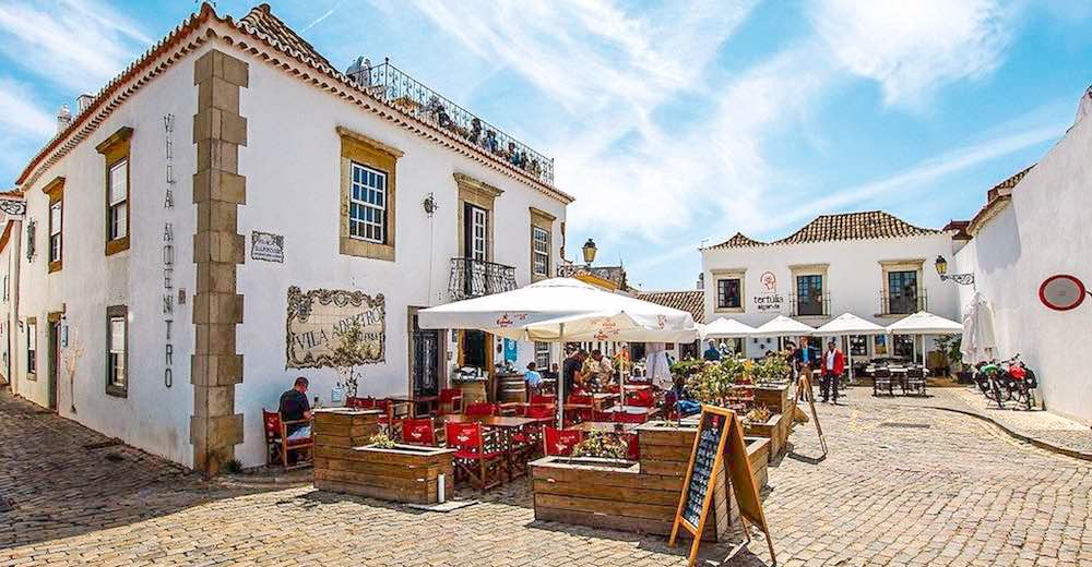 Whitewashed buildings and cobbed streets in old town Faro Portugal