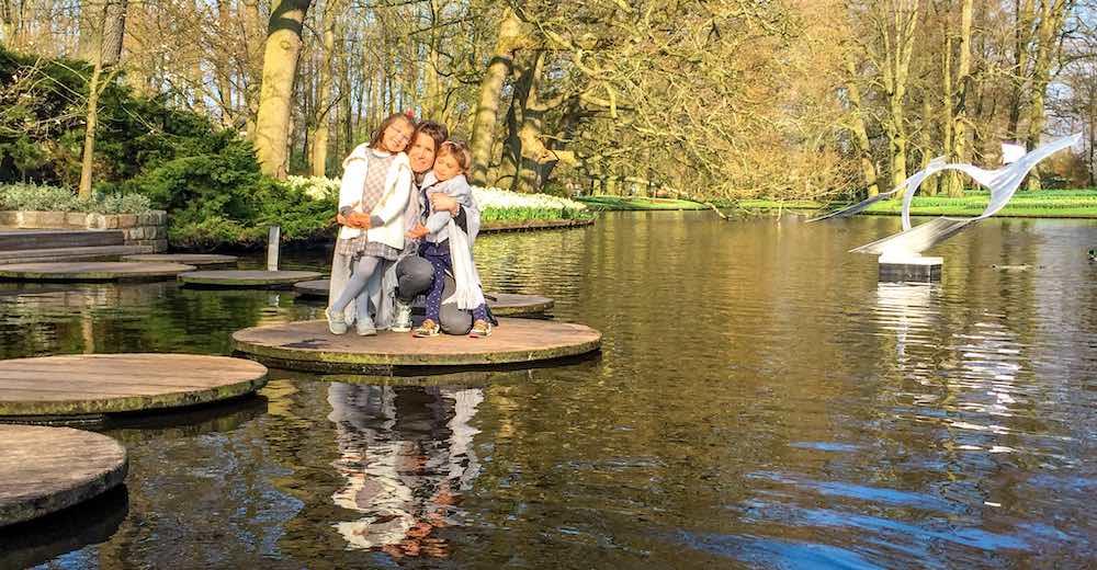 Mother and two girls at Keukenhof tulip garden in Amsterdam