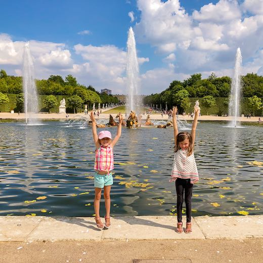 Two little girls visiting Versailles on a  day trip from Paris