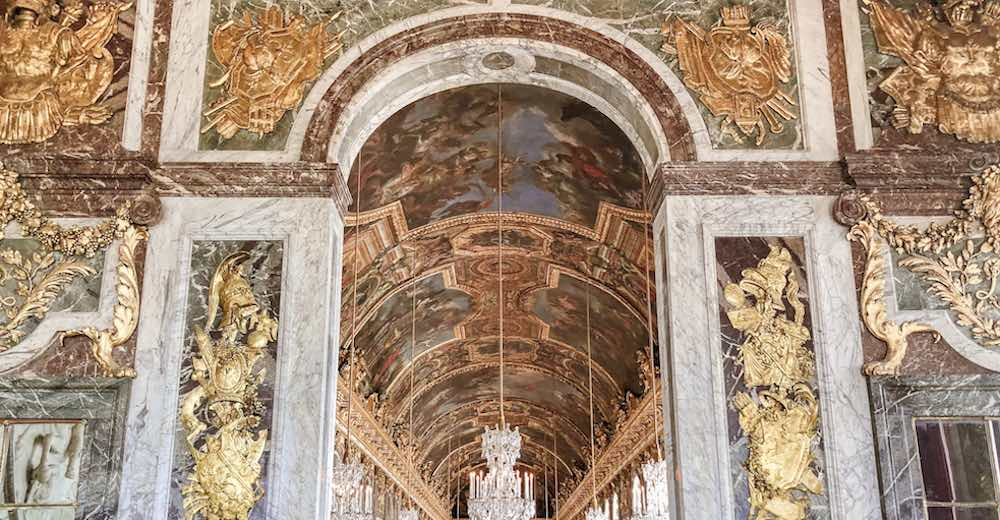 Adorned wall giving access to the Hall of Mirrors Versailles France