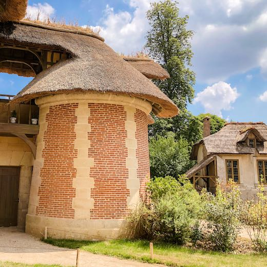 Include a visit to the Queen's Hamlet before taking the Versailles to Paris train