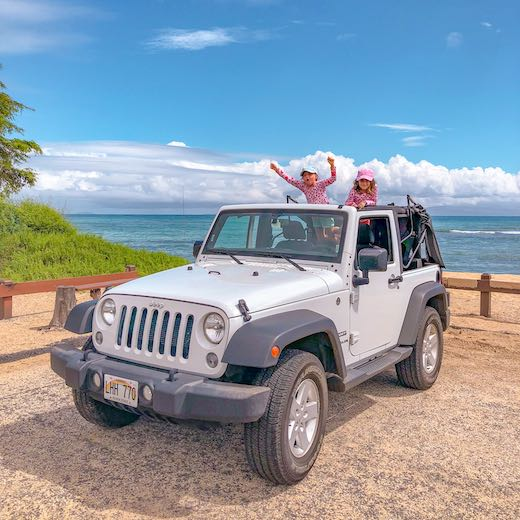 Two little girls in a Jeep Wrangler on Maui