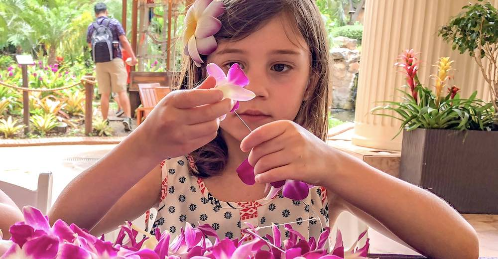 Making a fresh flower lei is one of the must-do things on Maui with kids