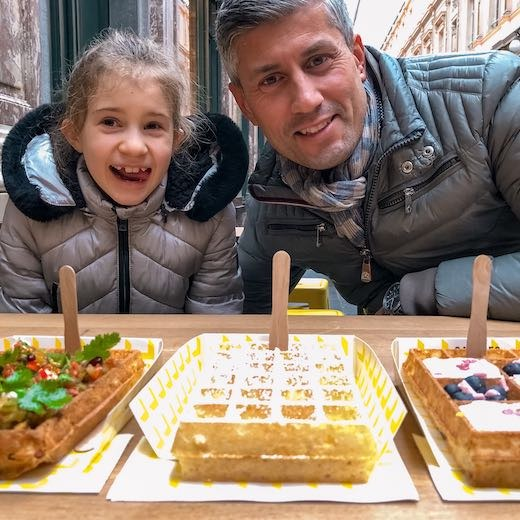 Dad and daughter ready to eat the best Belgian waffles in Brussels