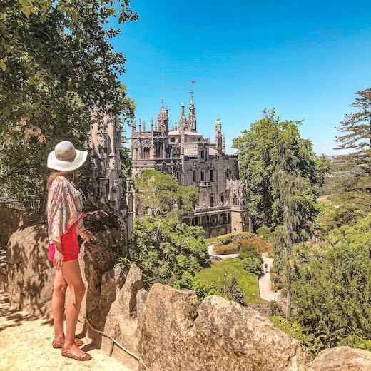 Woman overlooking Quinta da Regaleira Palace