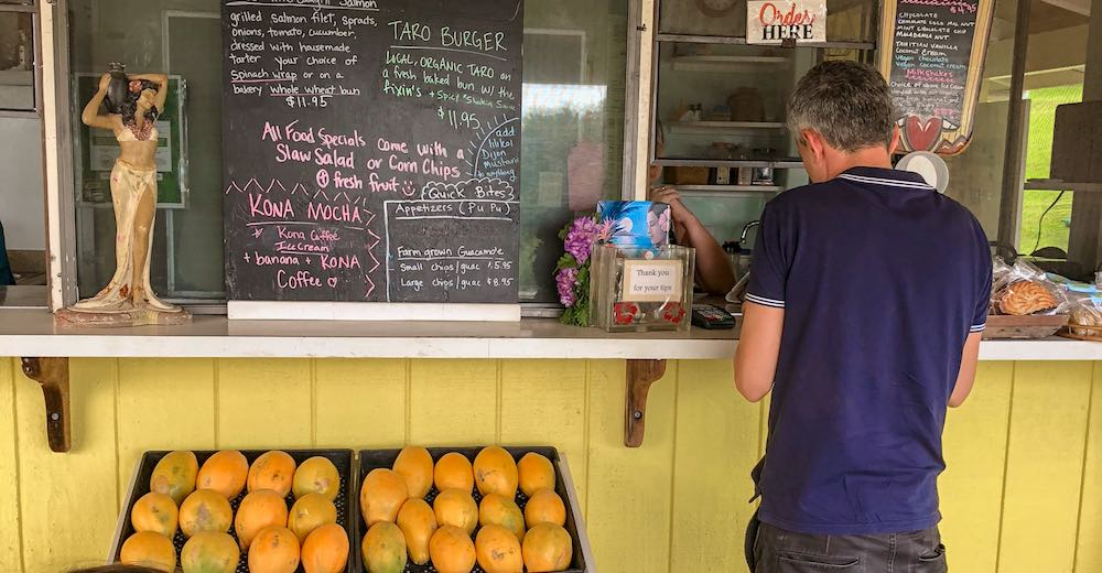 Man buying a refreshing smoothie after tackling one of the Big Island hikes