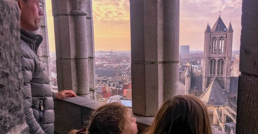 Sunset views over the city from the Ghent Belfry, climbing the steps to the tower is one of the best things to do in Ghent Belgium
