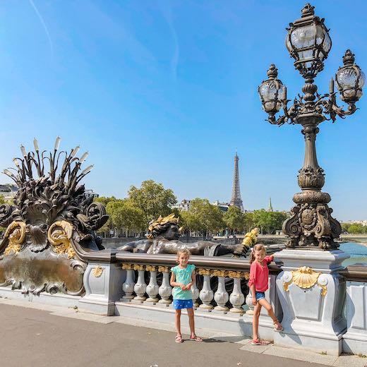 Two little girls at the Alexander III bridge in Paris