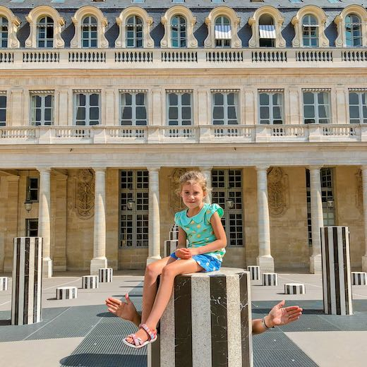 Little girl at the courtyard of the Palais Royal in Paris