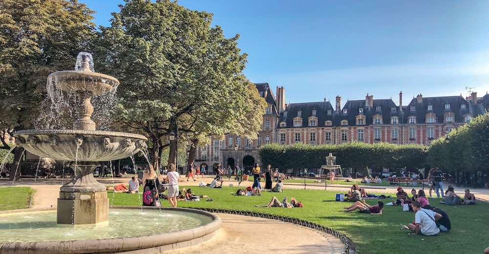 Fountain at the Place des Vosges in Paris France