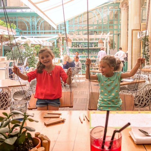 Two little girls enjoying lunch in Paris