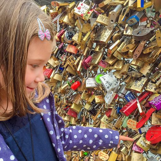 Little girl admiring the locks at the Pont des Arts in Paris