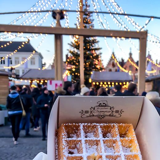Try a fluffy waffle at the Christmas market Bruges