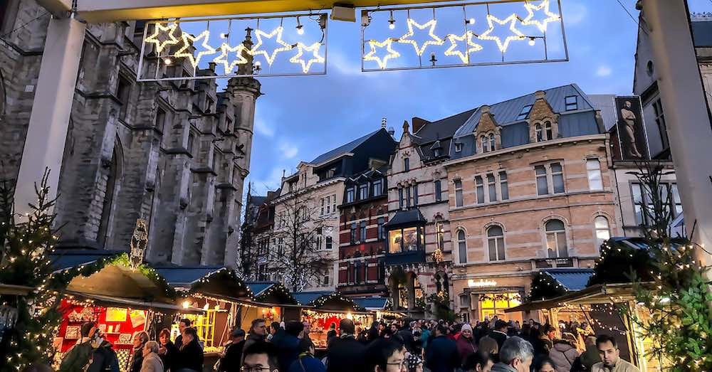 Wooden stalls and twinkling lights at St Baafsplein during the Ghent Belgium Christmas market