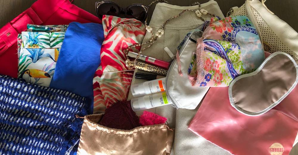 Packing for the beach list with a collection of clothes, nightwear, a sleeping mask and make-up bag