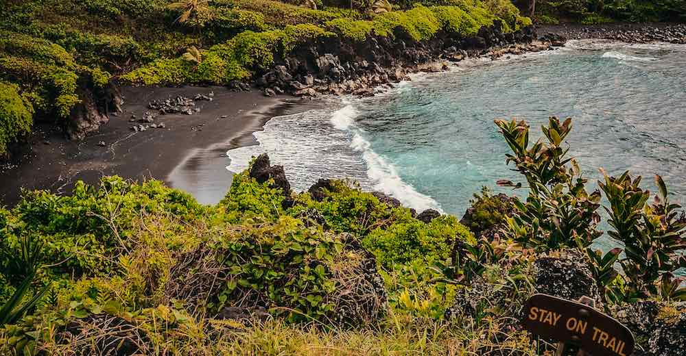Visiting the black sand beach  in Wai' anapanapa State Park is one of the essential things to do on Maui Hawaii