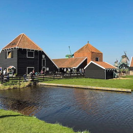 The typical Dutch windmill town of Zaanse Schans is one of the perfect day trips in North Holland