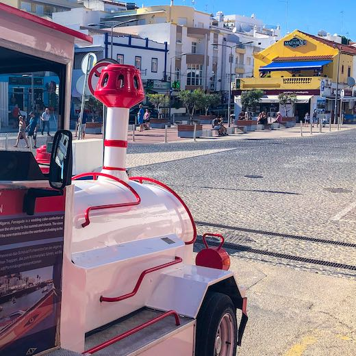 Little train connecting the Carvoeiro beaches, Carvoeiro restaurants and bars in Carvoeiro shopping street