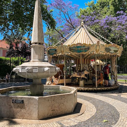 Take a carousel ride is one of the many fun things to do in Cascais old town with kids
