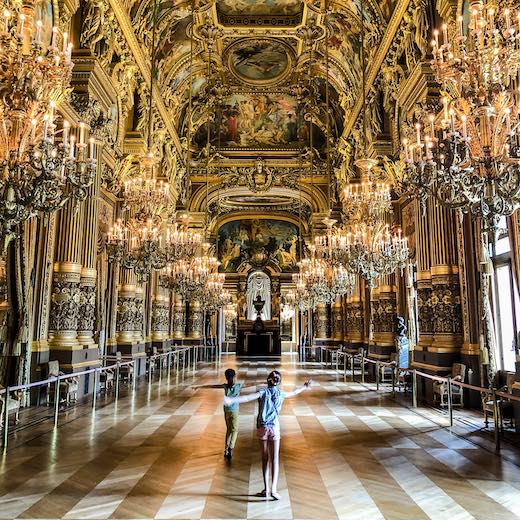 Two girls dancing in the Grand Foyer of the Opera House in Paris