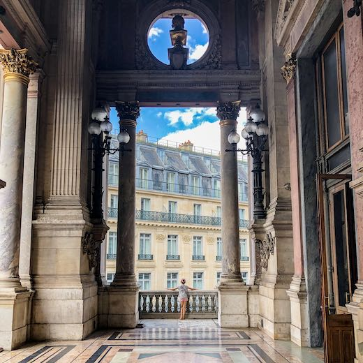 Little girl enjoying the view from the Palais Garnier loggia