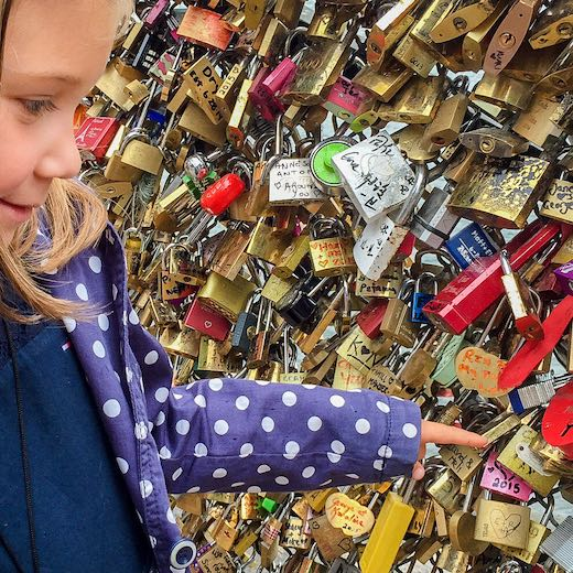 Little girl looking at the love locks at the Pont des Arts