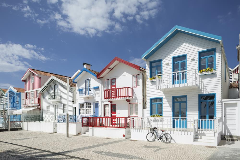These most colorful Airbnbs in Portugal are these striped houses at the Costa Nova