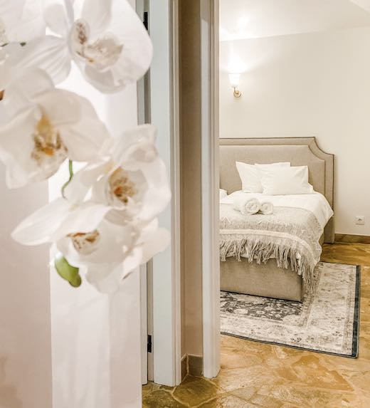 Orchids and a neutrally-toned bedroom in one of the renting villas in Portugal's Douro Valley