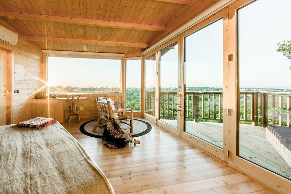Rustic interior of a tree house for rent in Portugal by the beach