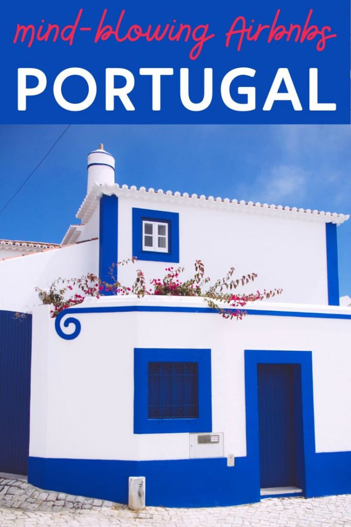Authentic white-washed house with bright blue accents as one of the Portugal Airbnb listings