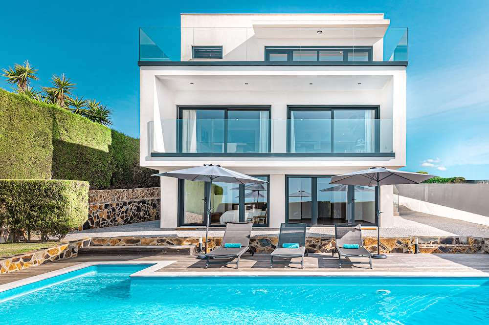 White modern villa with pool overlooking one of the best beaches in Algarve