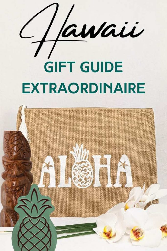 Collection of Hawaiian gifts, cosmetic bag with Aloha lettering, wooden tiki statue, pineapple tin and orchids