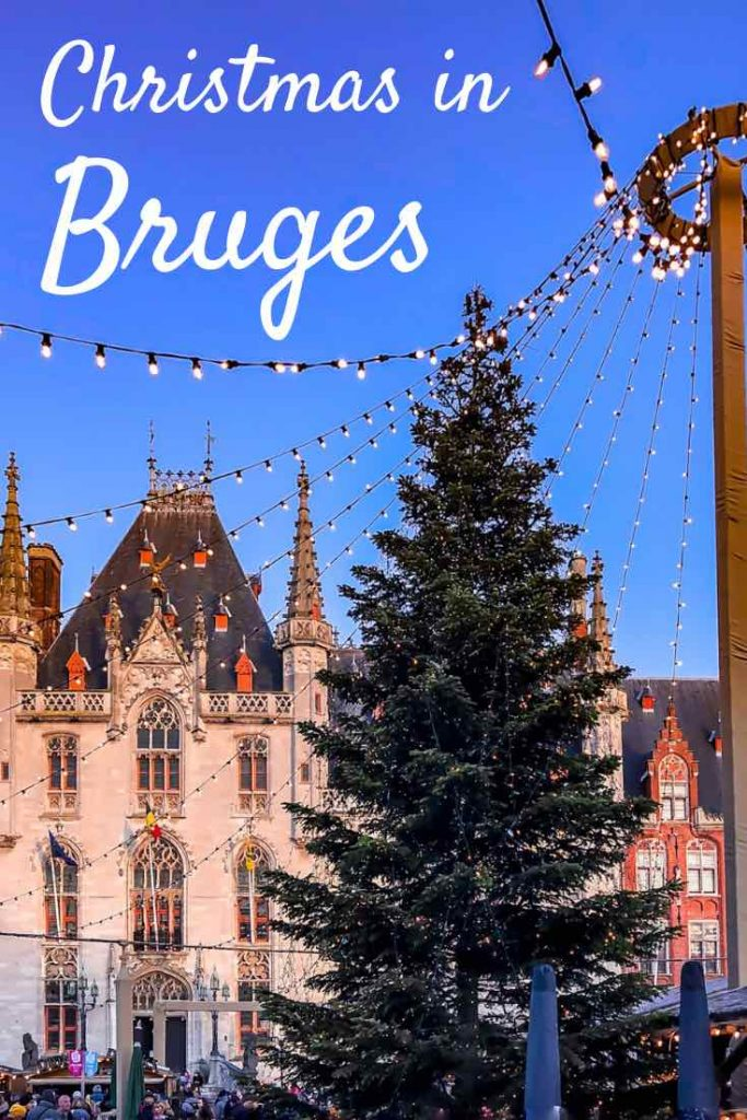 Bruges Christmas tree and strings of lights against a backdrop of medieval buildings