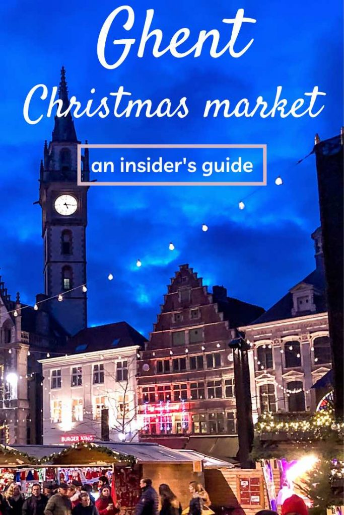 Stepped gable houses and clock tower decorated for the Ghent Christmas market