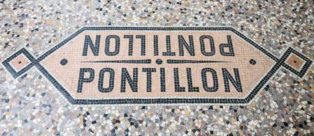 Mosaic floors still mention the names of some former Palais Royal stores