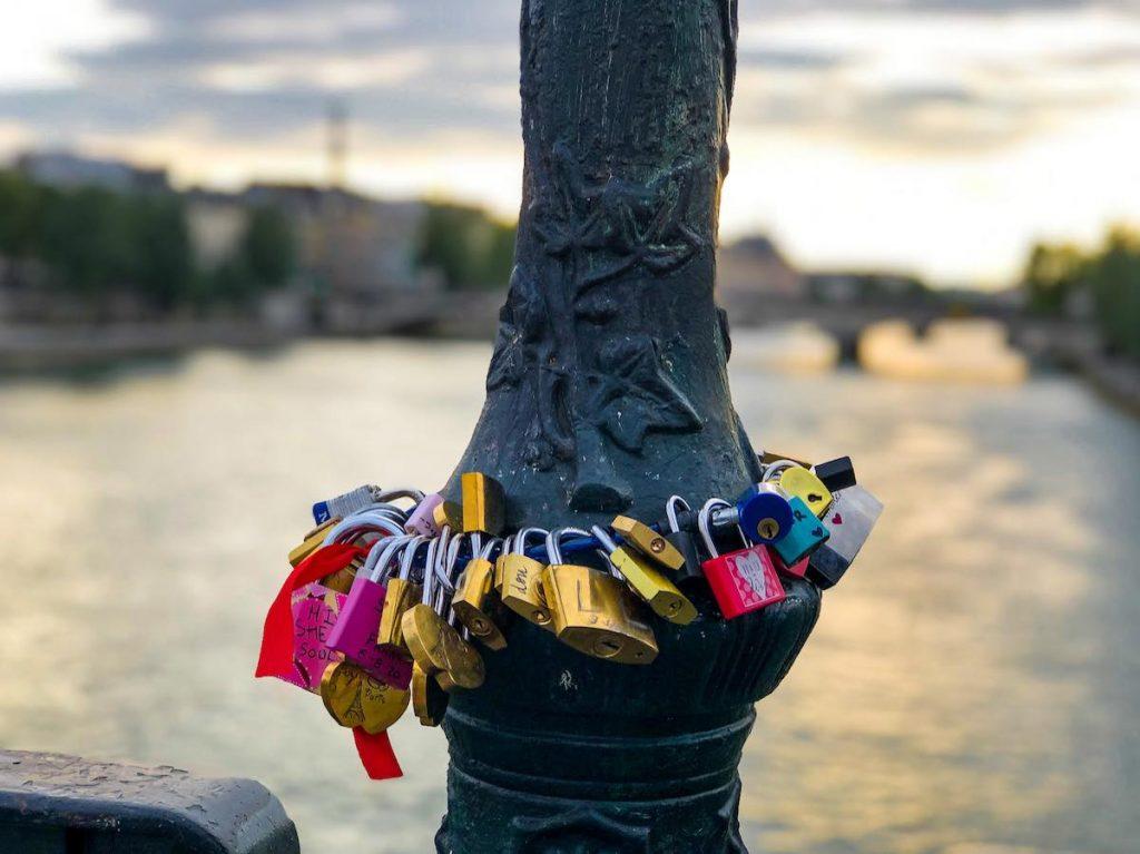 Love locks around a lamp post at the Pont des Arts Paris