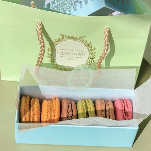 Shopping for a box of pastel-colored macarons from Laduree should be on every Paris travel guide