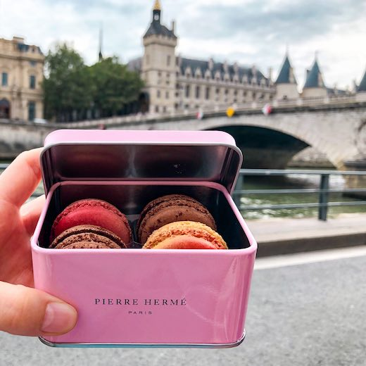A pink box with macarons, the sweet and famous food from Paris