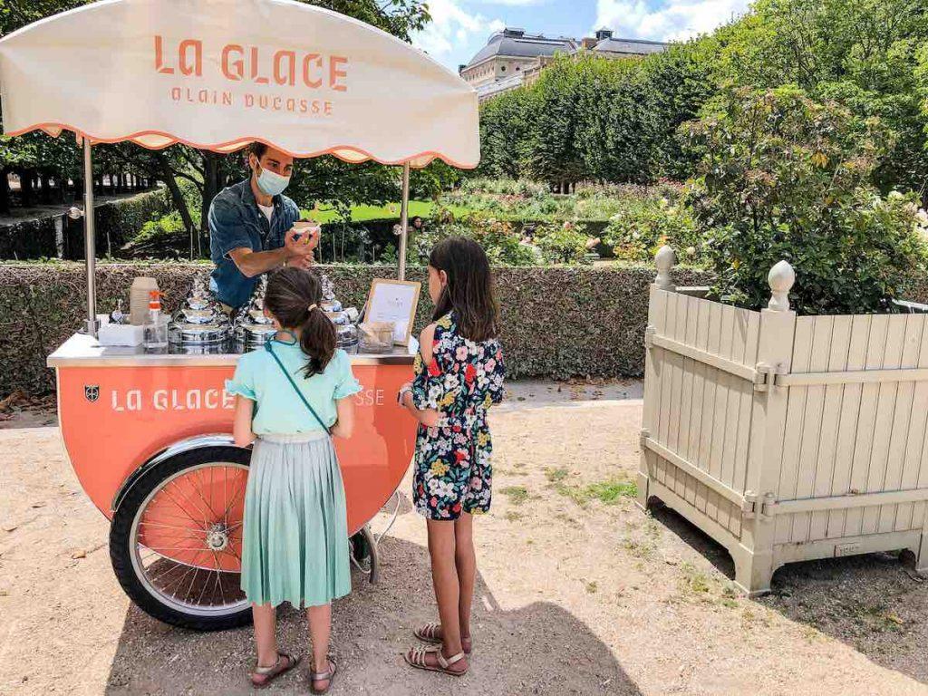 Two girls ordering ice cream in Paris